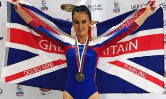GOLD FOR CAITLIN AT WORLD AGE DMT COMPETITION